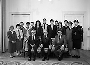 Gaisce, President's Award.  (S1)..1989..10.04.1989..04.10.1989..10th April 1989..President's award is Ireland's national challege. It involves 4 challanges for personal skills, community, venture and physical for bronze, silver or gold awards ...Image shows Seated; Mr Justice ,Liam Hamilton, President, Dr Patrick Hillery and Mr John Murphy,Executive Director, Gaisce, The President's Award..Standing are the award winners; Jacinta O'Neill,Dublin; Linda Henry,Cavan;Catherine Butler,Kilkenny; Sally McGroarty,Donegal; Derek Brannigan,Dublin; Mary McCarthy,Cork; James Roycroft,Cork; Joseph Treacy,Louth; Kenneth Purcell,Dublin; Martina Breen,Waterford; Derek McInerney,Limerick; Majella Killeen,Galway and Carolyn Hurley, Limerick at the Royal Hospital Kilmainham,Dublin.