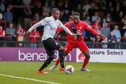 Mark Marshall and Marvin McCoy during the Capital One Cup match between York City and Bradford City at Bootham Crescent, York, England on 11 August 2015. Photo by Simon Davies.