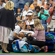 2019 US Open Tennis Tournament- Day Eight.   Naomi Osaka of Japan receives treatment during her loss to Belinda Bencic of Switzerland in the Women's Singles round four match on Arthur Ashe Stadium during the 2019 US Open Tennis Tournament at the USTA Billie Jean King National Tennis Center on September 2nd, 2019 in Flushing, Queens, New York City.  (Photo by Tim Clayton/Corbis via Getty Images)