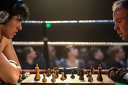 © Licensed to London News Pictures. 24/03/2013. London, UK. George Crespo (L) and Steve Philip compete in a bout of Chessboxing Grand Prix in Scala, London, Saturday evening 23 March 2013.   The hybrid sport combines chess with boxing in alternating rounds. The winner is decided by a knock out or checkmate, whichever comes first. A full match consists of eleven rounds: six rounds of chess, each four minutes long, and five rounds of boxing, each three minutes long (four minutes under amateur rules).[4] The match begins with a chess round which is followed by a boxing round. Rounds of chess and boxing alternate until the end of the match.[1][5] There is a one-minute break between each round, during which competitors cool out and change gear.. Photo credit : Peter Kollanyi/LNP