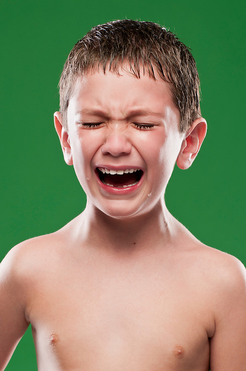 Portrait of boy crying, pain expression on face.