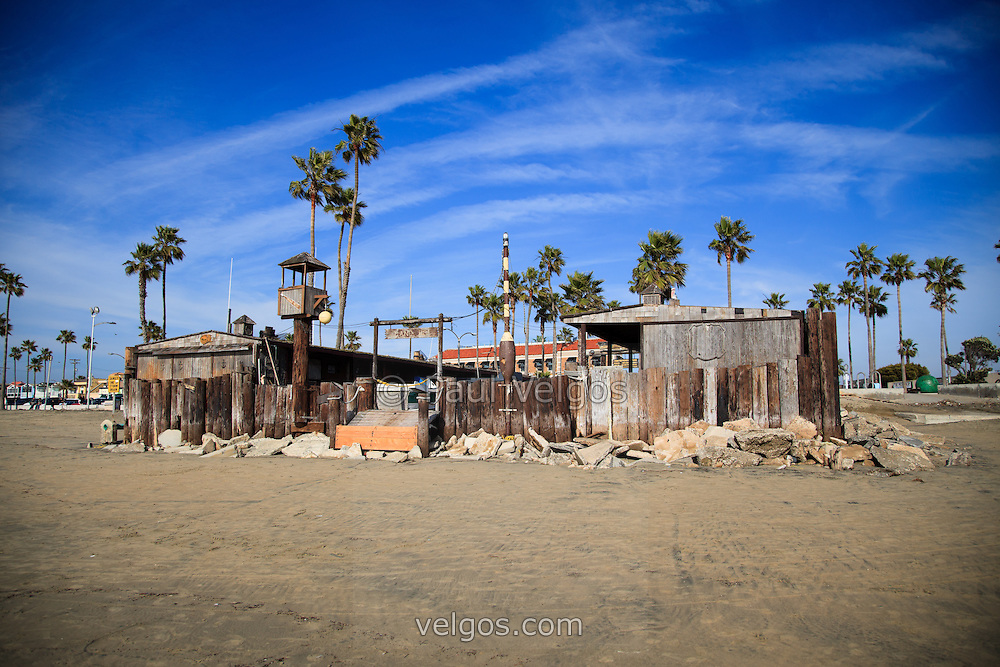 Photo of Dory Fishing Fleet Market from the west Pacific Ocean side. Dory Fishing Fleet is located next to Newport Pier on Balboa Peninsula in Orange County Southern California. The Dory Fishing Fleet Market is a historical landmark where Dory fisherman bring in and sell the daily catch at the Dory Fish Market. Photo is high resolution.