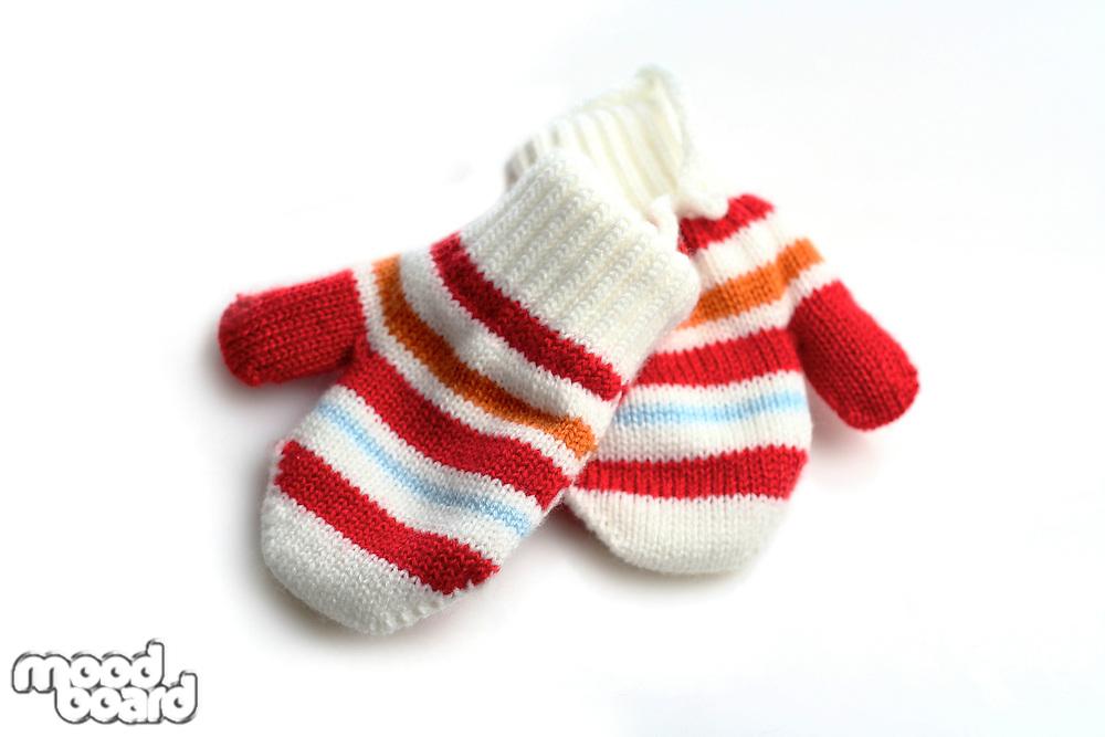 Baby gloves on white background