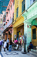 Colourful shophouses line the lively streets of Litte India in Kuala Lumpur.