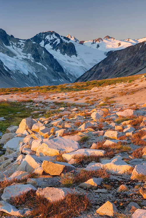 First rays of dawn casts a warm glow over the Peaks of Boulder/Salal Divide, Coast Range British Columbia Canada