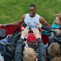 Brendon Rodney surrounded by the press following his 200m win over top sprinter Andre De Grasse
