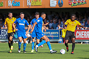 AFC Wimbledon defender Terell Thomas (6) battles for possession with Bristol Rovers midfielder Abu Ogogo (4) during the EFL Sky Bet League 1 match between AFC Wimbledon and Bristol Rovers at the Cherry Red Records Stadium, Kingston, England on 21 September 2019.