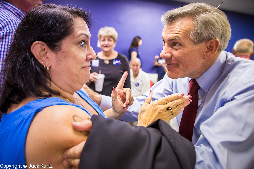 28 AUGUST 2012 - PHOENIX, AZ:    BRANDY BARON, a David Schweikert volunteer, greets Rep DAVID SCHWEIKERT (R-AZ), right, at Schweikert's victory party Tuesday. Schweikert faced Congressman Ben Quayle in what was the hardest Republican primary election in Arizona in 2012. Both were incumbent Republican freshmen elected to Congress from neighboring districts in 2010. They ended up in the same district at the end of the redistricting process and faced off against each other in the primary to represent Arizona's 6th Congressional District, which is made up of Scottsdale, Paradise Valley and parts of Phoenix. The district is solidly Republican and the winner of the primary is widely expected to win November's general election. Both are conservative Republicans with Tea Party backing.   PHOTO BY JACK KURTZ