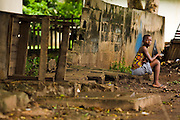 Girl sitting by the roadside in Dimbokro, Cote d'Ivoire, on Friday June 19, 2009.