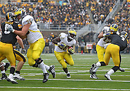 November 05, 2011: Michigan Wolverines running back Fitzgerald Toussaint (28) on a run during the first quarter of the NCAA football game between the Michigan Wolverines and the Iowa Hawkeyes at Kinnick Stadium in Iowa City, Iowa on Saturday, November 5, 2011. Iowa defeated Michigan 24-16.
