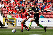 Swindon Town winger Keshi Anderson is challenged by Macclesfield Town defender Fiacre Kelleher during the EFL Sky Bet League 2 match between Swindon Town and Macclesfield Town at the County Ground, Swindon, England on 14 September 2019.