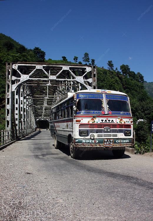 Nepali bus crosses bridge on Highway 1 near Butwal Nepal