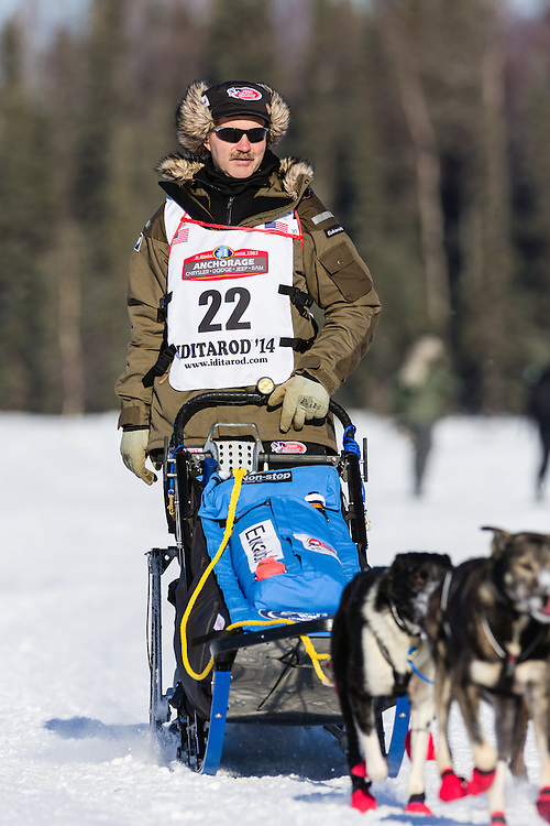 Musher Robert Sorlie competing in the 42nd Iditarod Trail Sled Dog Race on Long Lake after leaving the restart on Willow Lake in Southcentral Alaska.  Afternoon. Winter.