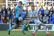 Shaun Pearson (C) (Grimsby Town) controls the ball under pressure from James Norwood (Tranmere Rovers) during the Vanarama National League match between Tranmere Rovers and Grimsby Town FC at Prenton Park, Birkenhead, England on 30 April 2016. Photo by Mark P Doherty.
