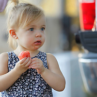 Thomas Wells | Buy at PHOTOS.DJOURNAL.COM<br /> Layna Becker, 2, enjoys a slice of watermelon during Wednesday's Festival on the field.
