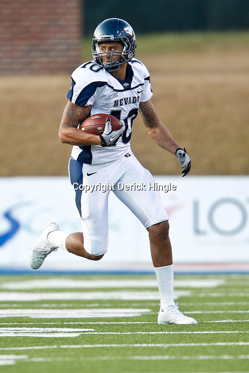 December 4, 2010; Ruston, LA, USA;  Nevada Wolf Pack quarterback Colin Kaepernick (10) against the Louisiana Tech Bulldogs during the second half at Joe Aillet Stadium.  Nevada defeated Louisiana Tech 35-17. Mandatory Credit: Derick E. Hingle
