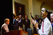 Pete Souza talks about being Barack Obama's presidential photographer during his Kennedy Lecture on September 19, 2017. He took this photo when the Affordable Care Act was passed.