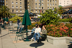 California, San Francisco: Couple relaxing at Union Square. Photo 6-casanf79191.  Photo copyright Lee Foster.