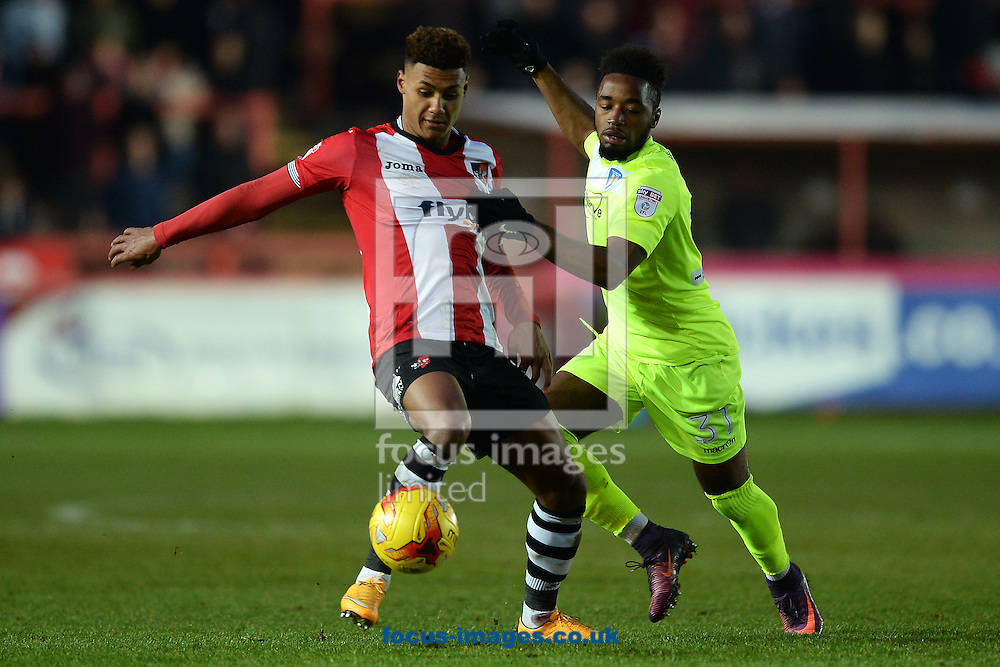 Ollie Watkins of Exeter City does battle with Tariqe Fosu of Colchester United during the Sky Bet League 2 match between Exeter City and Colchester United at St James' Park, Exeter<br /> Picture by Richard Blaxall/Focus Images Ltd +44 7853 364624<br /> 21/01/2017