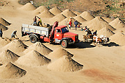 Madagascar, Anosy region, near Tolagnaro (Fort Dauphin) Collecting sand from the dunes
