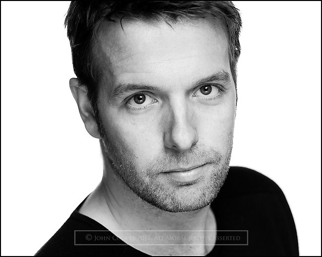 Headshot of actor, Steven Rae.