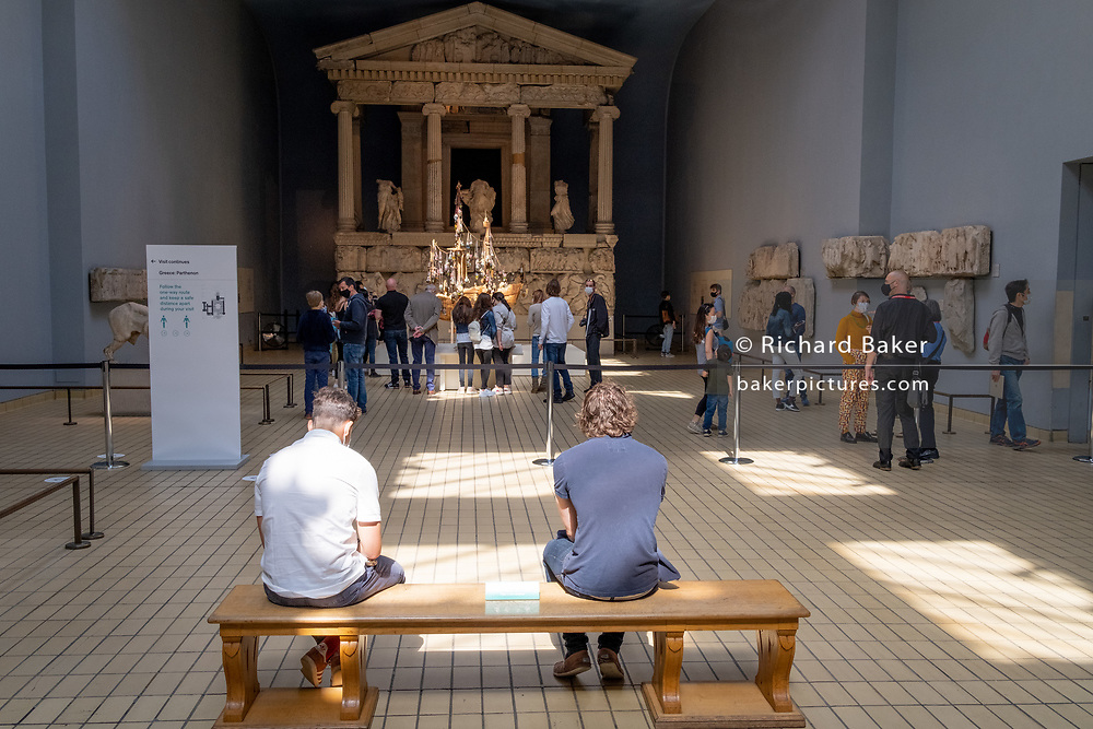 Now re-opened after months of closure during the Coronavirus pandemic, some of the first visitors who have pre-booked free tickets, once again enjoy looking at the Nereid Monument (constructed 390-380BC and restored in the 1960s) and other historical artifacts at the British Museum, on 2nd September 2020, in London, England.