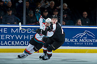 KELOWNA, CANADA - MARCH 7:  Ted Brennan #10 of the Kelowna Rockets is checked by Bowen Byram #44 of the Vancouver Giants during first period on March 7, 2018 at Prospera Place in Kelowna, British Columbia, Canada.  (Photo by Marissa Baecker/Shoot the Breeze)  *** Local Caption ***