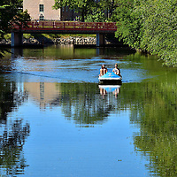 Paddleboat on Kungsparken Canal in Malm&ouml;, Sweden<br /> Kungsparken is a 21 acre city park offering something for everyone. Since opening in 1872, King&rsquo;s Park has hosted a large organic garden, unique species of mature trees, summer events and concerts, plenty of green space, a casino and nightclub, a 15th century Renaissance fortress and an old Dutch windmill. Or maybe you prefer to idle away your afternoon on a rented paddleboat like this couple. In the background is the quaint girder Slottsbron. The span is called the Castle Bridge because it leads towards the Malm&ouml;hus Castle.