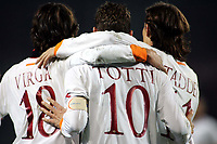"Taddei e Virga  festeggiano  Totti (Roma) dopo il gol<br />Italian ""Serie A"" 2006-2007<br />20 Dic 2006 (Match Day 17)<br />Torino-Roma<br />""Giuseppe Meazza"" Stadium-Milano-Italy<br />Photographer:Jennifer Lorenzini INSIDE"