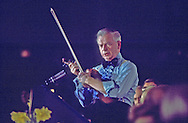 Senator Robert Byrd plays the fiddle at a congressional dinner in February 1977.  Assignment for TIME. One used in TIME  2/7/77 page 22...Photograph by Dennis Brack bb 21