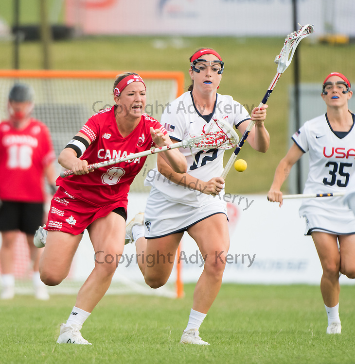 Canada's Katie Guy fights for possession with USA's Kayla Treanor at the 2017 FIL Rathbones Women's Lacrosse World Cup at Surrey Sports Park, Guilford, Surrey, UK, 15th July 2017