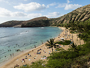 The beach at Hanauma Bay Nature Preserve hosts a popular snorkeling area run by the City and County of Honolulu, in the Hawaii Kai neighborhood, on the island of Oahu, Hawaii, USA. After decades of overcrowding, Hanauma Bay is now better managed as the first Marine Life Conservation District in the State, which attempts to sustain the stressed reef which hosts a great variety of tropical fish. Feeding the fish is no longer allowed and the park is closed on Tuesdays to allow the fish a day of rest undisturbed. Hanauma Bay formed within the tuff ring of an eroded volcanic crater along the southeast coast of Oahu.
