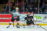 KELOWNA, BC - FEBRUARY 7:  Kyle Topping #24 of the Kelowna Rockets looks for the pass in front of the net of David Tendeck #30 of the Vancouver Giants at Prospera Place on February 7, 2018 in Kelowna, Canada. (Photo by Marissa Baecker/Getty Images)