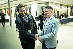 © Licensed to London News Pictures . 26/05/2019. Manchester, UK. EITAN GILBOORD (Yaxley-Lennon's election agent) and STEPHEN YAXLEY-LENNON (aka Tommy Robinson ) arrive . The count for seats in the constituency of North West England in the European Parliamentary election , at Manchester Central convention centre . Photo credit: Joel Goodman/LNP