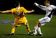 9 NOV. 2010 -- ST. LOUIS -- Christian Brothers College High School soccer player Matt Clarkin (6) battles St. Louis University High School's Tommy Behr (20) for control of the ball during the MSHSAA Class 3 Sectional game at SLUH Tuesday, Nov. 9, 2010. The Jr. Bills won, 2-1, on a pair of first half goals by Ryan Merrifield. SLUH will take on Jackson High School Saturday, Nov. 13 at Jackson. Image © copyright 2010 Sid Hastings.