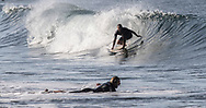 Surfers at Venice Beach, CA. Tuesday morning on June 27, 2017. <br /> <br /> photo by Samuel Navarro