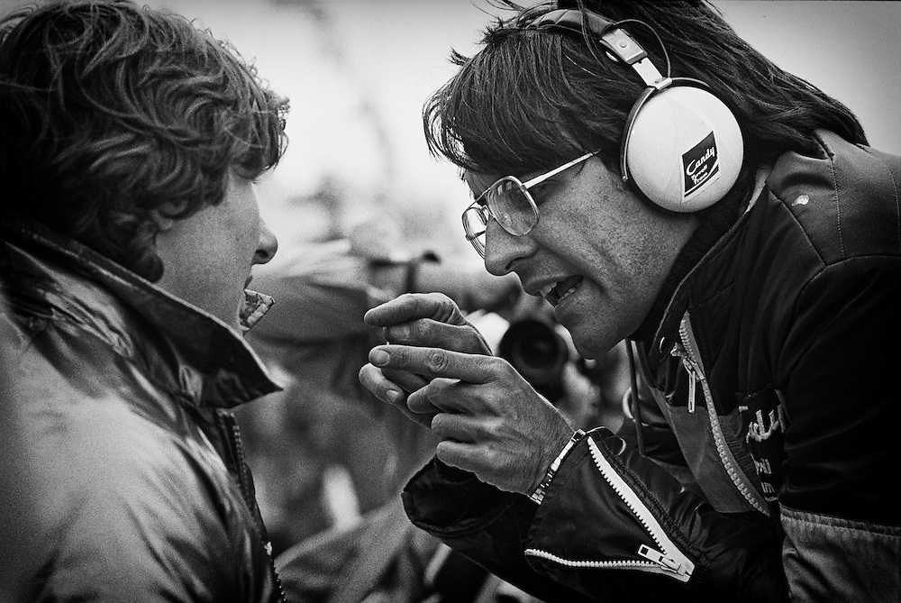 Jean-Pierre Jarier receives feedback from a Candy Team Tyrrell-Ford racing engineer during the 1979 United States Grand Prix. <br />