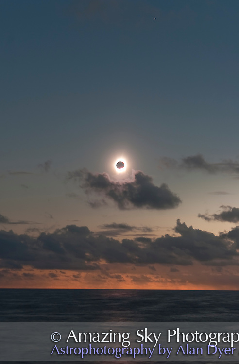 July 21, 2009 total solar eclipse near third contact as shadow leaves the horizon and is about to hit the Sun coming toward us. Totality is about to end. Taken from Northern Cook Islands, at sea on m/s Paul Gauguin. Using 20Da and 28-105mm lens at 60mm at f/5 and ISO100. Mercury, blurred ny ship's motion, at top.