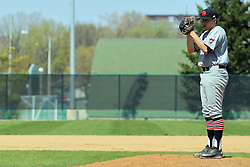 17 April 2016:  Starting pitcher Russell Hoh during an NCAA division 3 College Conference of Illinois and Wisconsin (CCIW) Pay in Baseball game during the Conference Championship series between the North Central Cardinals and the Illinois Wesleyan Titans at Jack Horenberger Stadium, Bloomington IL