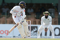 July 19, 2018 - Colombo, Sri Lanka - Sri Lankan cricketer Dhananjaya de Silva is hit in the chest with the ball during the first day of the 2nd test cricket match between Sri Lanka and South Africa at SSC International Cricket ground, Colombo, Sri Lanka on Friday 20 July 2018. (Credit Image: © Tharaka Basnayaka/NurPhoto via ZUMA Press)