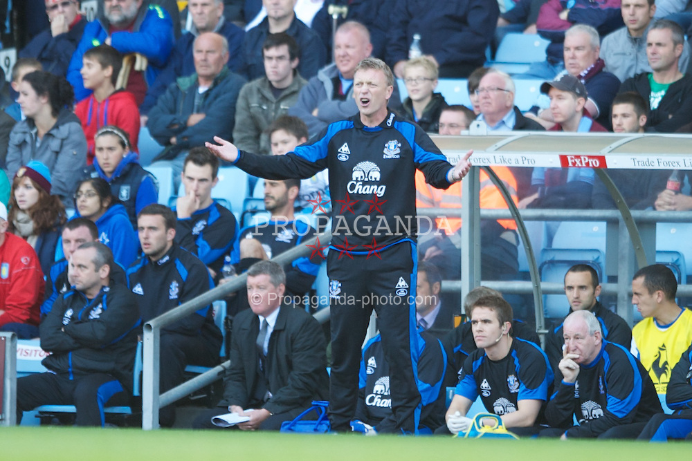 BIRMINGHAM, ENGLAND - Sunday, August 29, 2010: Everton's manager David Moyes looks dejected during the Premiership match at Villa Park. (Photo by Chris Brunskill/Propaganda)