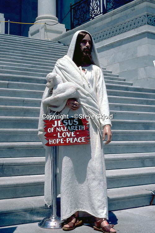 Mannequin capturing the look of Jesus on capitol steps.  Washington DC USA