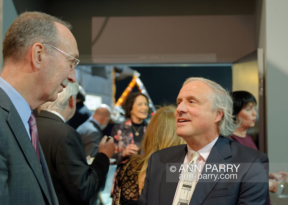 Garden City, New York, U.S. November 14, 2019. L-R, GARY LEWI and CAM Curator JOSHUA STOFF talk with each other during Cocktail Hour at the  17th Annual Cradle of Aviation Museum Air and Space Gala, an event that helps support the development of new activities and educational programs, and honors the innovations of leaders in aviation, technical achievement, and leadership.