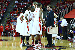 07 January 2012: Bryant Allen, John Wilkins, Jordan Threloff and Tyler Brown huddle up with Tim Jankovich during an NCAA Missouri Valley Conference mens basketball game Where the Purple Aces of Evansville lost to the Illinois State Redbirds 75-73 in Redbird Arena, Normal IL