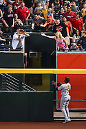 Apr 23, 2016; Phoenix, AZ, USA; Pittsburgh Pirates outfielder Gregory Polanco (25) watches as a fan catches Arizona Diamondbacks outfielder David Peralta (not pictured) home run in the third inning at Chase Field. The Arizona Diamondbacks won 7-1. Mandatory Credit: Jennifer Stewart-USA TODAY Sports