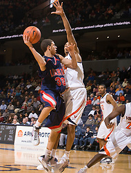 Liberty guard Seth Curry (30) is guarded by Virginia guard Sylven Landesberg (15).  The Virginia Cavaliers fell to the Liberty Flames 86-82 in NCAA Division 1 men's basketball at the University of Virginia's John Paul Jones Arena  in Charlottesville, VA on March 9, 2008.
