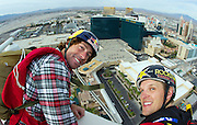 From left, Travis Pastrana is seen with Erik Roner preparing to base jump off The Signature at the MGM Grand Hotel & Casino on Wednesday June 1, 2011 in Las Vegas to promote the North American debut of Nitro Circus Live at the MGM Grand Garden Arena on Saturday June 4, 2011.(Jeff Bottari/AP Images for Nitro Circus Live)