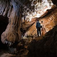 Speleologist in underground cave