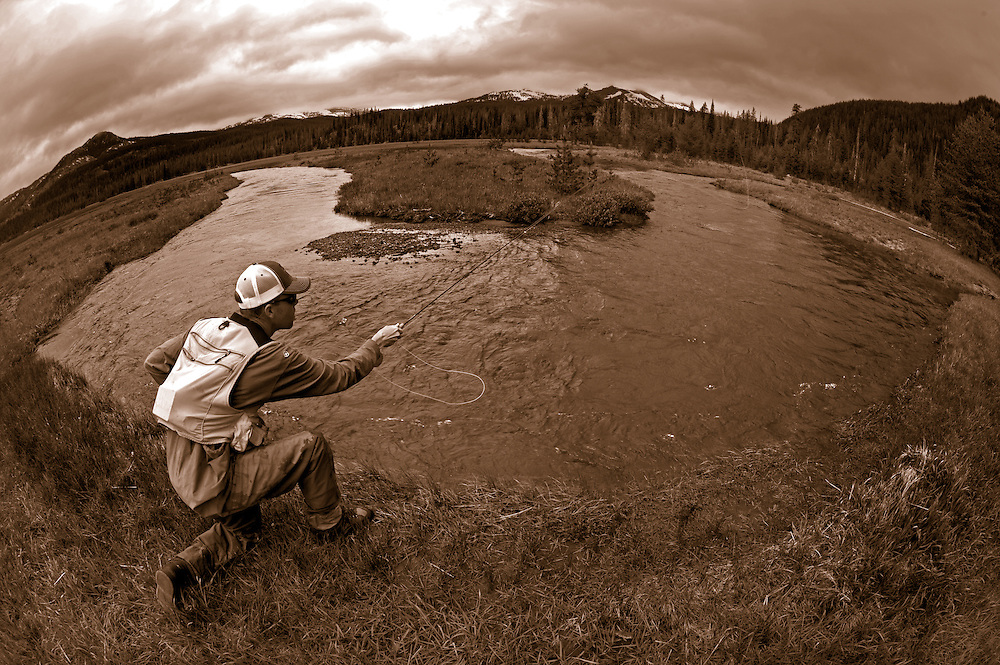 A fly fisherman cast to a rising trout while fishing a high mountain stream.