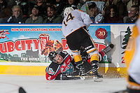 KELOWNA, CANADA - DECEMBER 3: James Hilsendager #2 of the Kelowna Rockets is checked to the ice during second period by Ty Lewis #14 of the Brandon Wheat Kings  on December 3, 2016 at Prospera Place in Kelowna, British Columbia, Canada.  (Photo by Marissa Baecker/Shoot the Breeze)  *** Local Caption ***